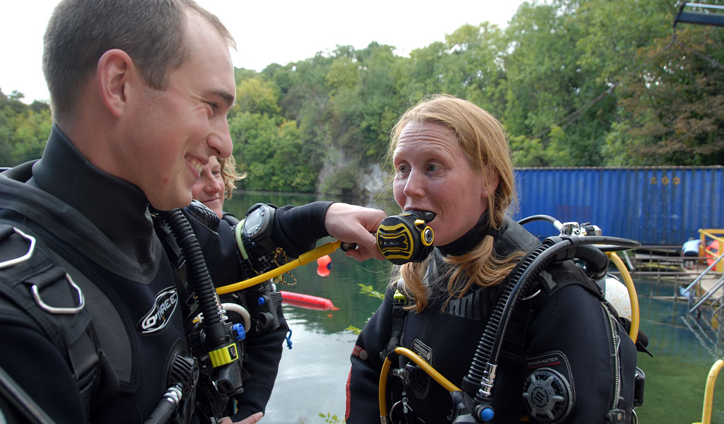 Instructor with students in Dive Leader training