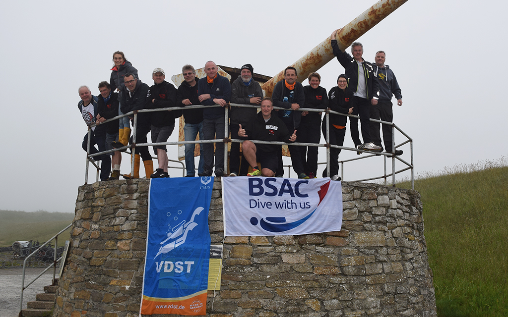The BSAC and VDST team topside, flying the flags of their organisations before the dive.