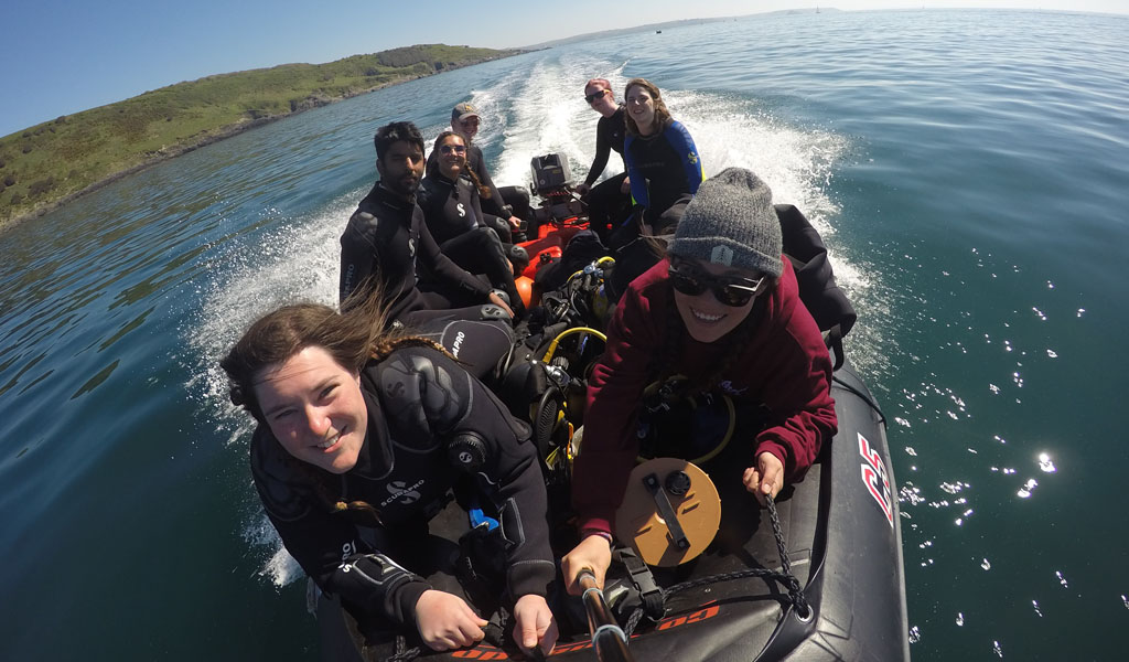 A group of BSAC divers out on a boat ready to dive