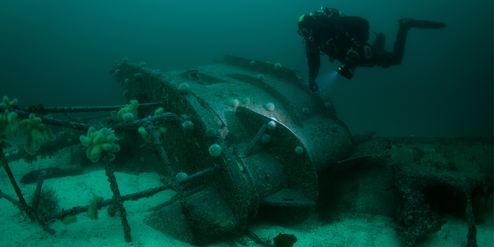 Diver approaching wreck in Shetland