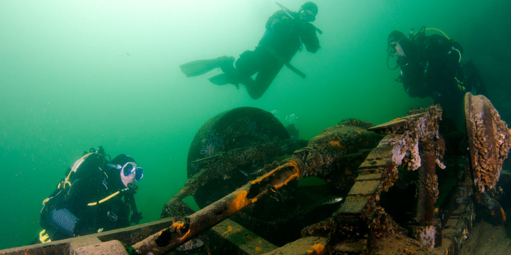 Under water wreck image with scuba divers