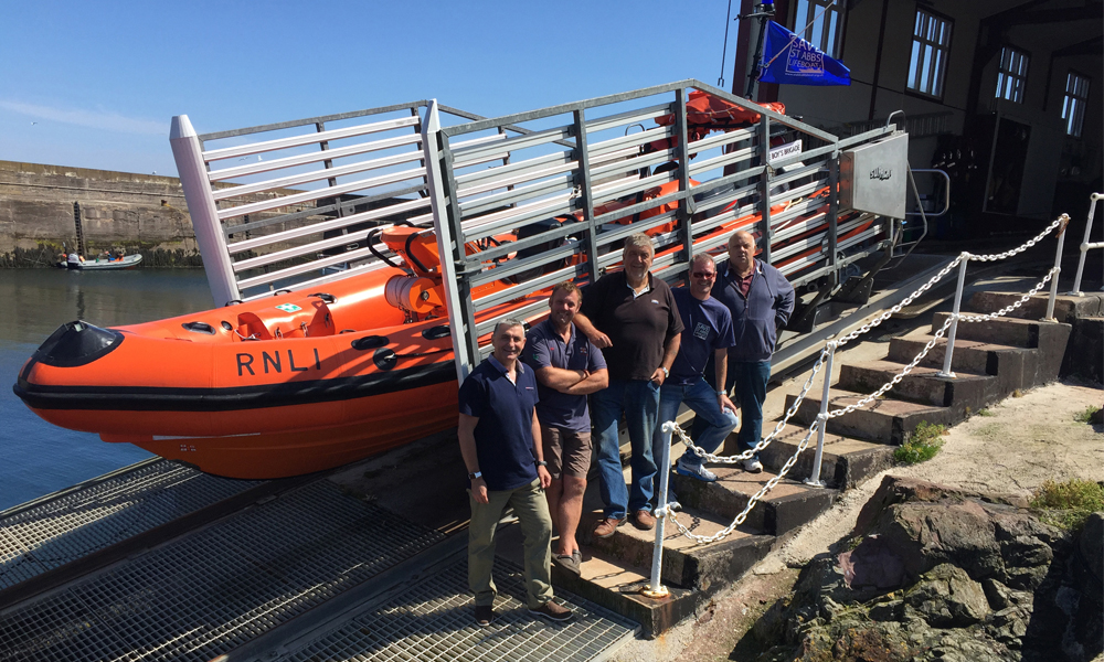 BSAC - Eugene Farrell with St Abbs team at Lifeboat Station with RIB