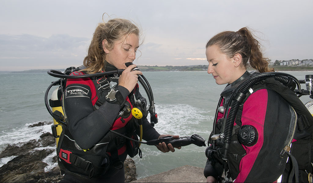 Dive buddies carrying out a buddy check before a dive