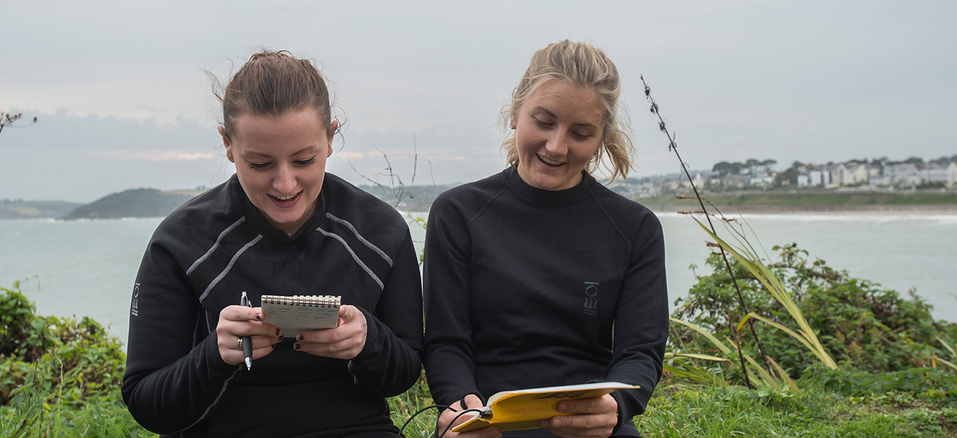 Two female divers plan before a dive